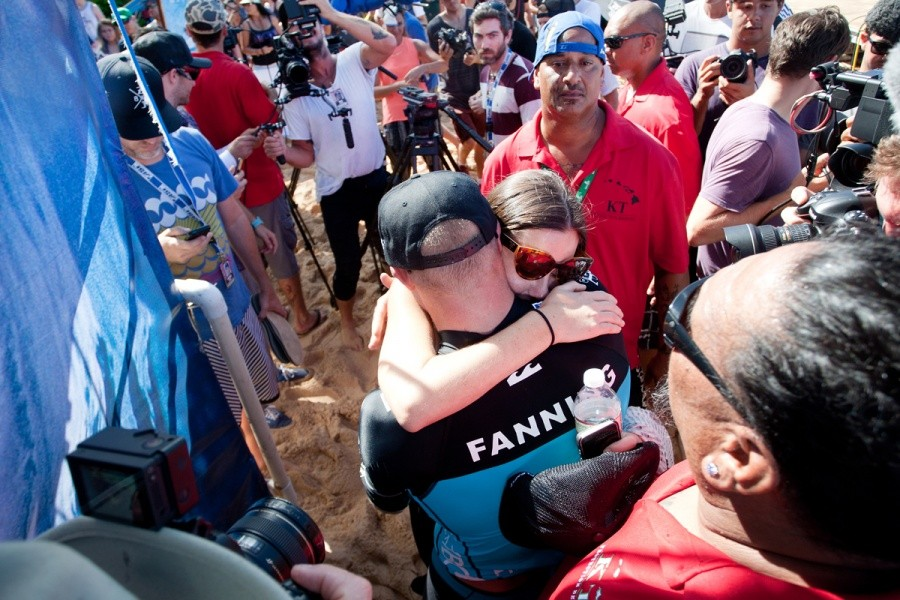Mick Fanning (AUS) embraces his wife Karissa after a long year battling for the World Title and finally winning it today.    © ASP / Cestari