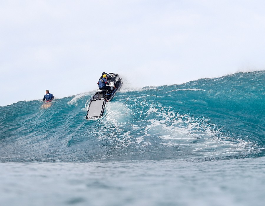 Water patrol dodging a few rogue sets.   © WSL / Cestari